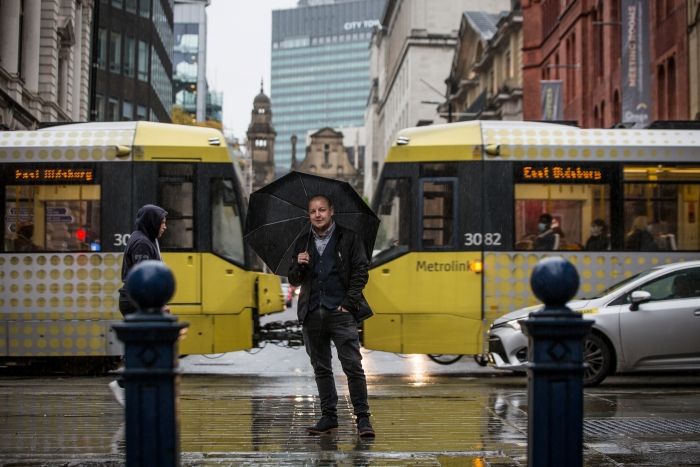 man with umbrella in Manchester